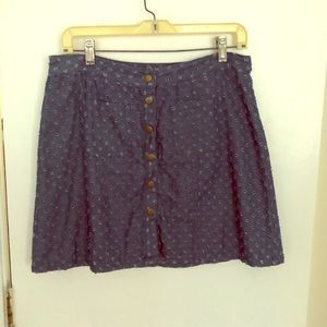 Denim skirt with buttons and fabric details